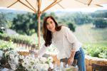 April Gargiulo at a table in a vineyard