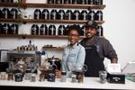 Alfonso and Jamila, founders of Brooklyn Tea in their store