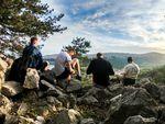 men talking on mountain